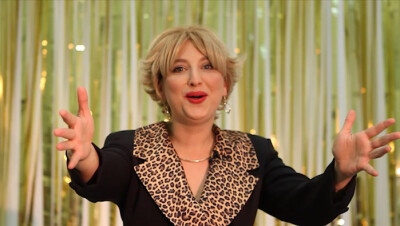 The O Show: Female Masculinity (video still of Oriana the host delivering her opening monologue)